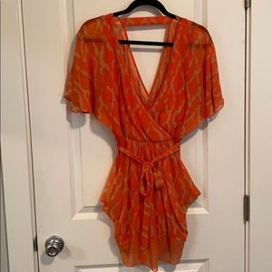 Orange and cream colored dress
